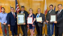 El Centro's Veteran of The Year, Tracy Rascoe, stands with Assemblymember Garcia as he gets recognized for his service.