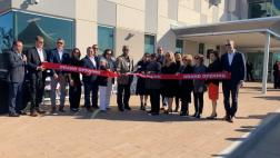 Participants cut ribbon at El Centro Health Center grand opening.